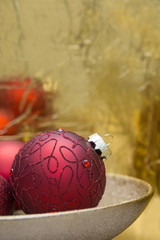 Elegant Christmas decoration with red baubles in golden bowl, perfect for greeting card, gift wrapping paper or Christmas background