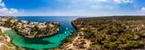 Luftaufnahme, Spanien, Balearen, Mallorca, Gemeinde Llucmajor,  Bucht Cala Pi mit Strand und Felsenküste und Tore de Cala Pi - 229153843