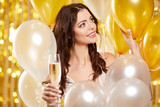 Woman in evening dress with champagne glasses - new year, celebration - 229156249