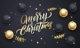 Merry Christmas golden calligraphy lettering and Xmas gold stars, balls and confetti decoration. Vector Xmas holiday black background design - 229169632