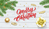 Merry Christmas or Xmas gold stars decoration. Vector Xmas tree ornaments and calligraphy lettering on wood - 229169693