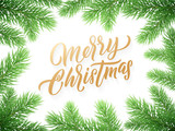 Gold Christmas card lettering on white background with green Christmas trees branches frame - 229170202