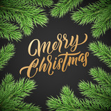 Christmas card gold lettering on black background with green Christmas trees branches frame - 229170288