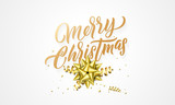 Merry Christmas greeting card of golden glittering hand drawn calligraphy text and golden decoration on background design template - 229170490