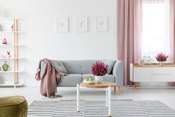 Sofa and table with heath in real photo of interior