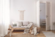 Artisan and natural decorations and accessories in a warm living room interior with wooden furniture and hardwood floor