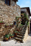 Floral streets of Spello in Umbria, Italy. - 229182496