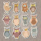 Set of cute stickers with cartoon owls. Vector.