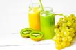 Leinwanddruck Bild - Fresh detox juices in glass bottles on white background