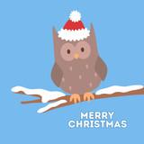 Cute christmas owl in red Santa hat