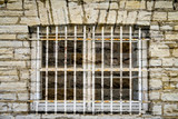 old jail window in limestone wall