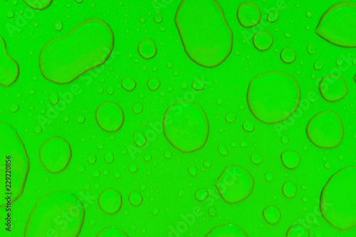 Leinwandbild Motiv Drops of water on a green background, texture