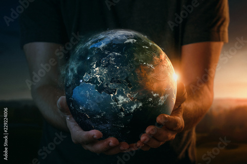 Leinwanddruck Bild Planet earth in human hands. Elements of this image furnished by NASA