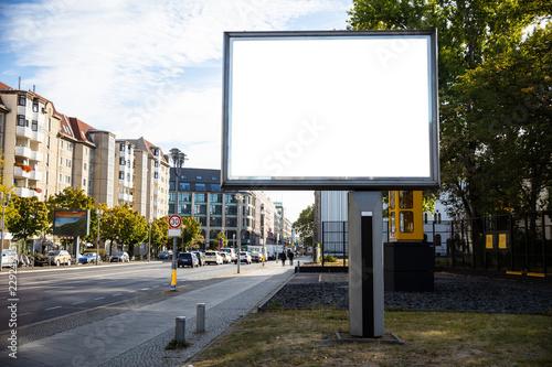 Leinwanddruck Bild Blank billboard mockup for advertising, City street background