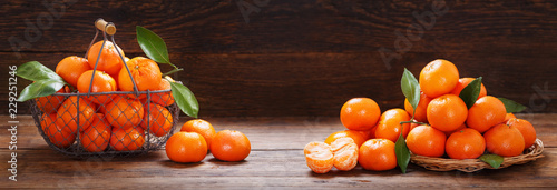 Fresh mandarin oranges fruit or tangerines on wooden table - 229251246
