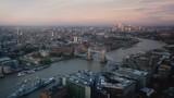 time lapse London skyline with illuminated Tower bridge and Canary Wharf in sunset time, UK