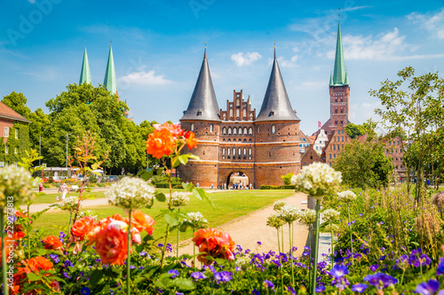 Leinwandbild Motiv Historic town of Lübeck with Holstentor gate in summer, Schleswig-Holstein, northern Germany