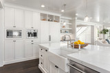 White Kitchen Detail in New Luxury Home: Shows Sink, Dishwasher, Refrigerator, Microwave, and Coffee Maker - 229294604