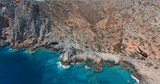 Descending above clear blue waters on stunning rocky coast in Greek island of Crete . - 229319280