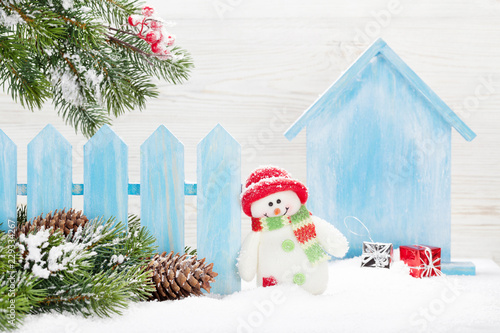 Christmas snowman toy and fir tree branch - 229334267