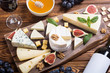 Leinwanddruck Bild - Cheeseboard with cheese brie , parmesan , camembert and dorblu
