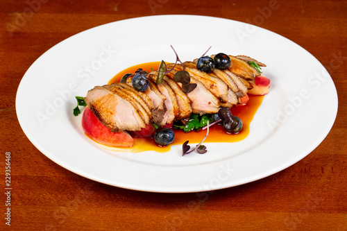 Baked duck breast with peach - 229356468