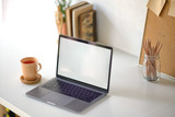 Workspace of creative designer with blank screen laptop. - 229364649