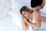 Portrait of unhappy young couple in bedroom - 229366853