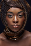 portrait of stylish african american model with head wrap isolated on black - 229385688