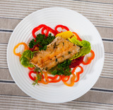 Top view of fried trout fillets with vegetables - 229406211