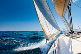 Sailing lboat at open sea in sunshine - 229409051