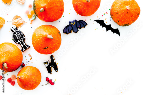 Halloween symbols. Pumpkins and cute figures of halloween evils. Bats. white background top view space for text - 229409034