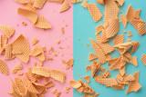 Crushed ice cream waffle cones on pastel pink blue background