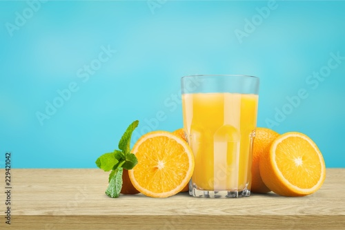 Orange juice and slices of orange on background - 229421042