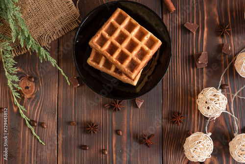 Wall mural Tasty fresh Vienna wafers, jam and cup of coffee on a dark wooden background