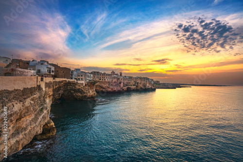 Leinwanddruck Bild Polignano a Mare village at sunset, Bari, Apulia, Italy.