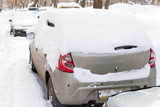 Car under snow on a parking after blizzard - 229451422