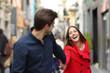 Leinwanddruck Bild - Couple running together in the street