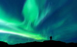 Aurora borealis with silhouette love romantic couple on the mountain.Honeymoon travel concept - 229525038