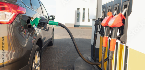 Refueling the vehicle at a gas station - 229543669