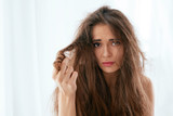 Hair Problem. Woman With Dry And Damaged Long Hair - 229562434