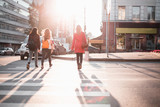 People walk in streets of at sunset - 229563622