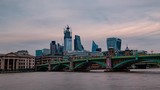Timelapse view of the City of London at sunset across the river Thames - 229581846