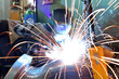 welder at work in steel construction in industry // Schweißer im Metallbau am Arbeitsplatz