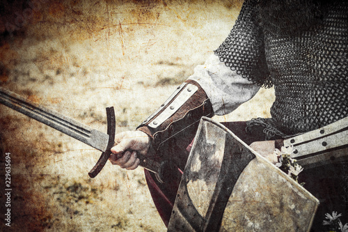 photo of the brave warrior holding his sword and shield