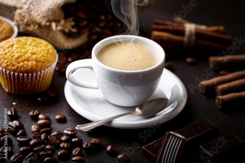 Black coffee on old background - 229649461