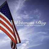American flags with a Veterans Day greeting with blue sky baacakground - 229653461