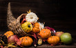 A Thanksgiving holiday decorative cornucopia with pumpkins, squash, leaves etc