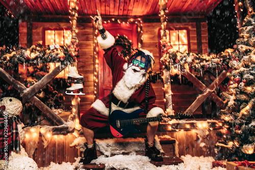 Leinwanddruck Bild cool rocker santa