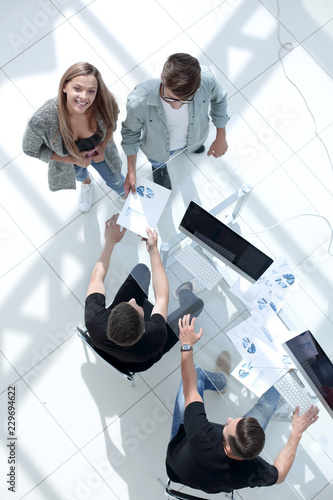 Leinwanddruck Bild High angle view of businessmen at table in office